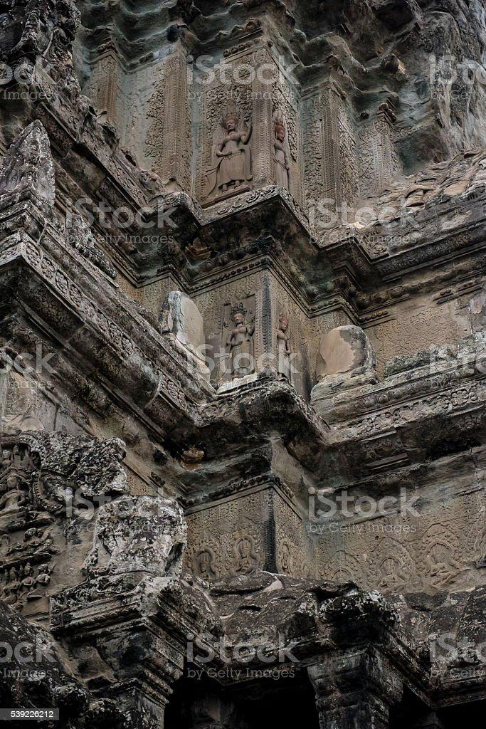 Carvings on Angkor Wat walls stock photo