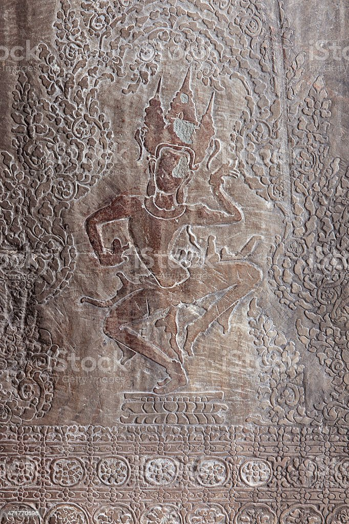 Carvings on the wall of Angkor Wat Temple stock photo