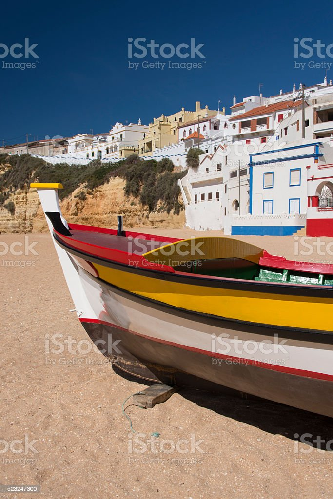 Carvoeiro beach with fishingboat stock photo