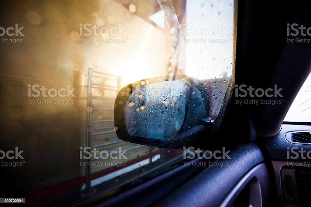 carwash with high pressure cleaner stock photo