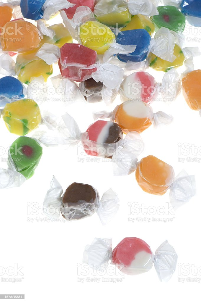 Cascade background of varied flavored salt water taffy on white stock photo