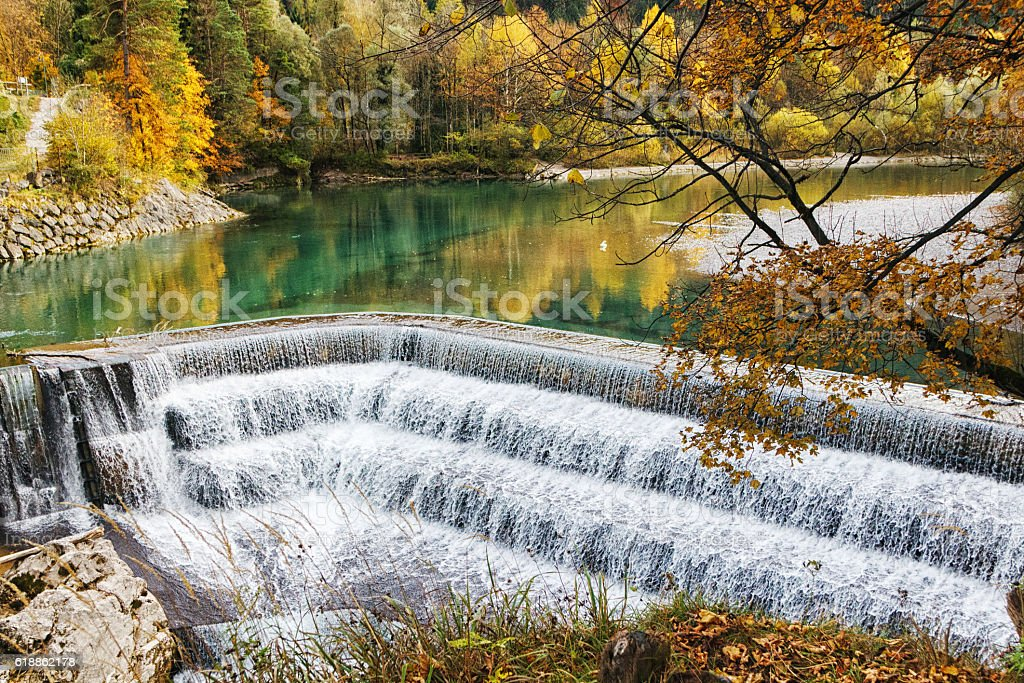 Cascade waterfall in a colorful autumn forest stock photo