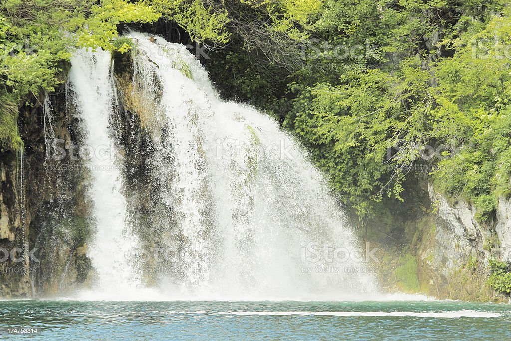 cascades waterfall with streaming water into turquoise lake  Plitvice Croatia royalty-free stock photo