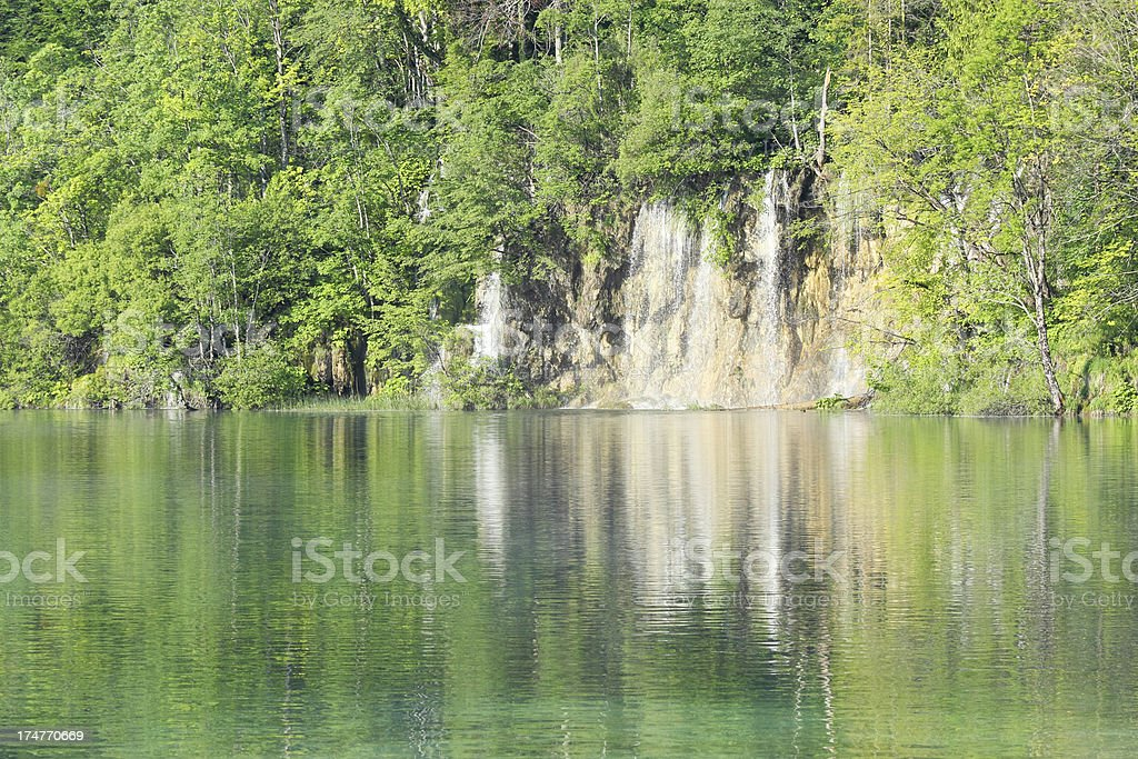 cascades with streaming water into green lake  Plitvice Croatia royalty-free stock photo