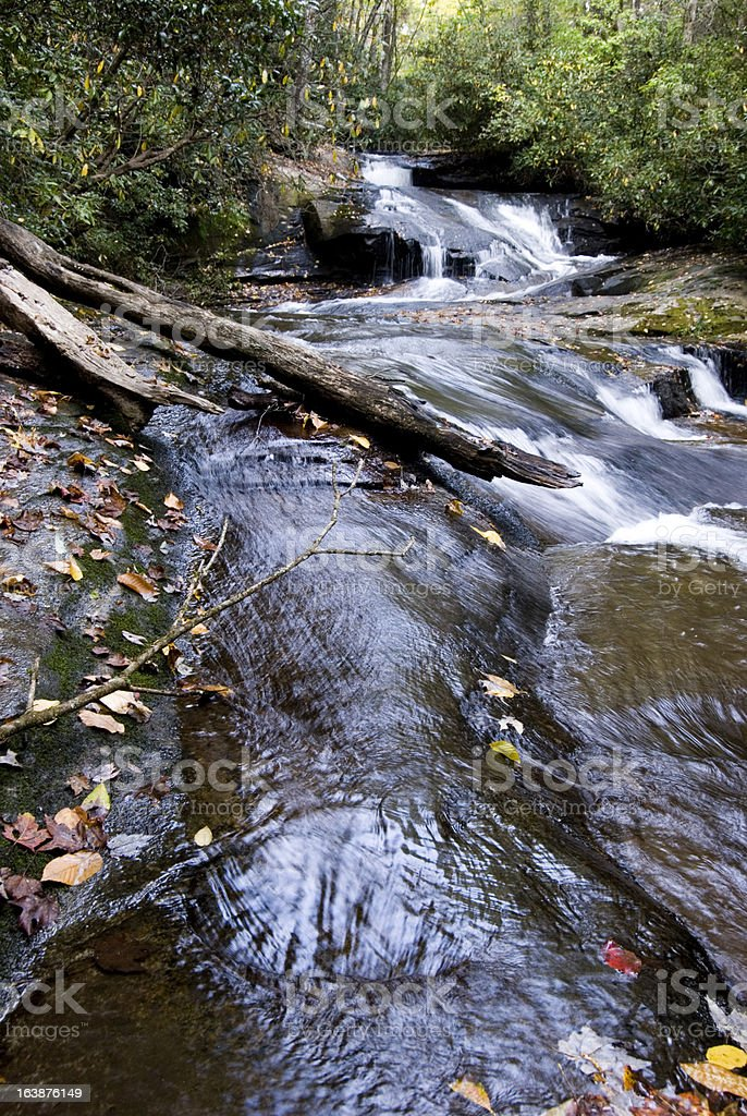 Cascading falls over boulder royalty-free stock photo