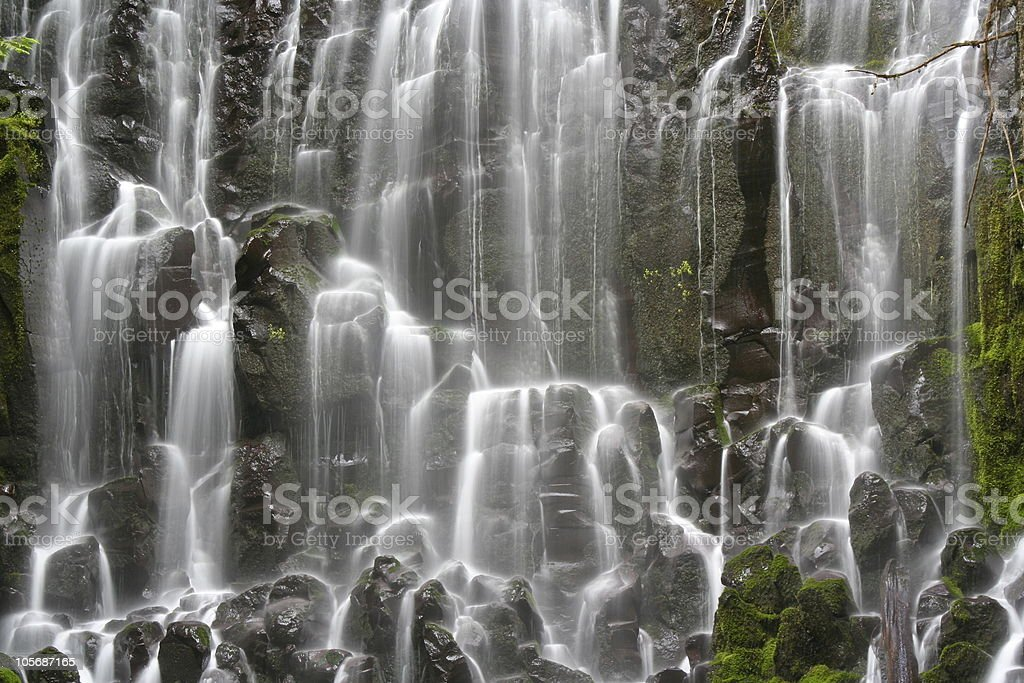 Cascading Waterfall over Moss Coverd Rocks royalty-free stock photo