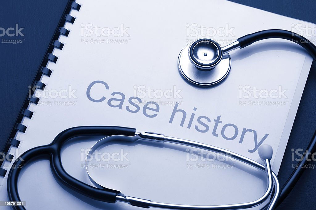 Case history and stethoscope on black royalty-free stock photo