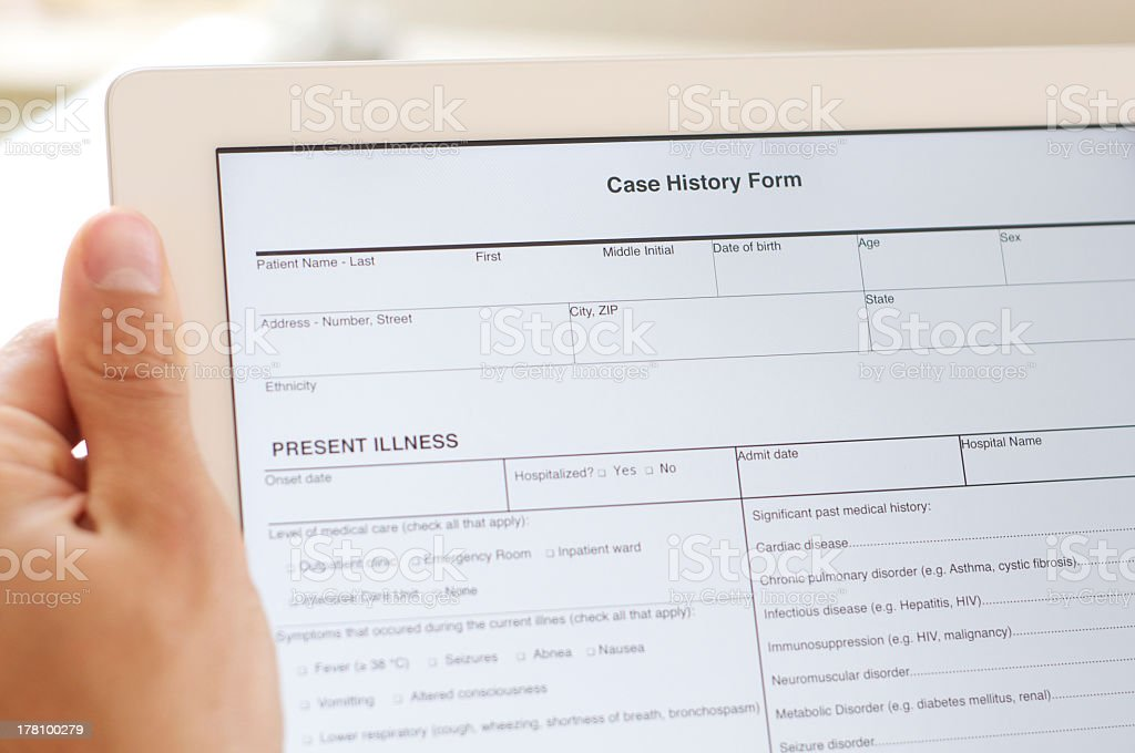 case history form on digital tablet stock photo