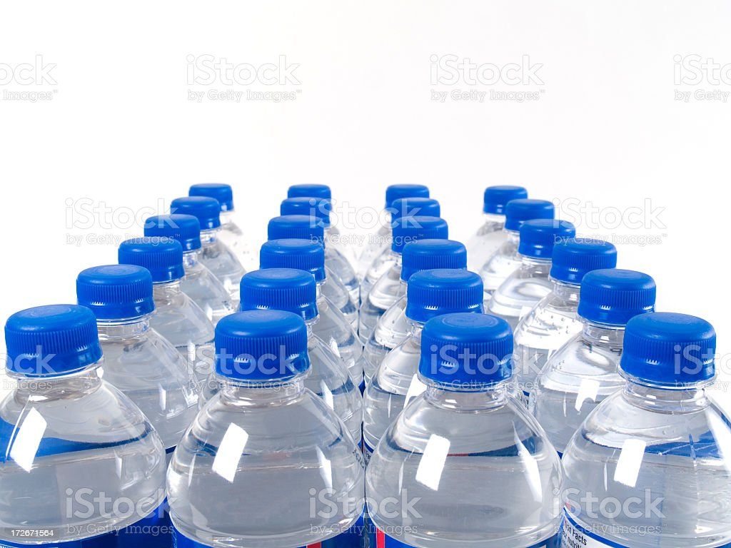 Case of filled water bottles with blue caps stock photo