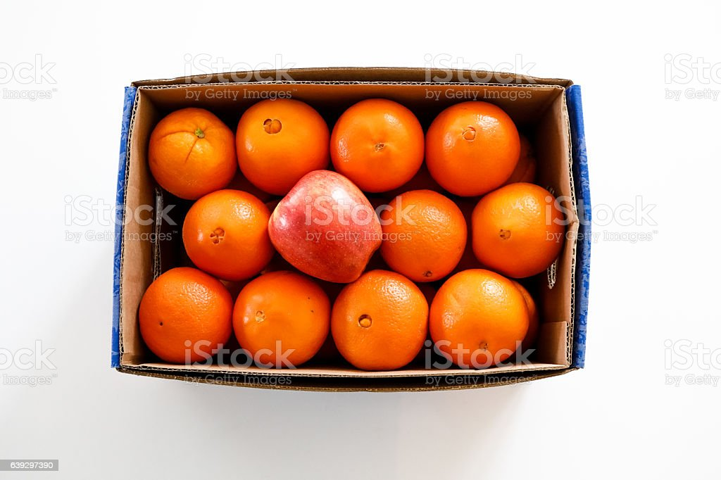 Case of Oranges and an Apple stock photo