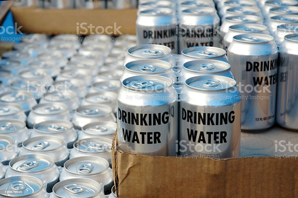Cases of cans of drinking water for disaster relief stock photo