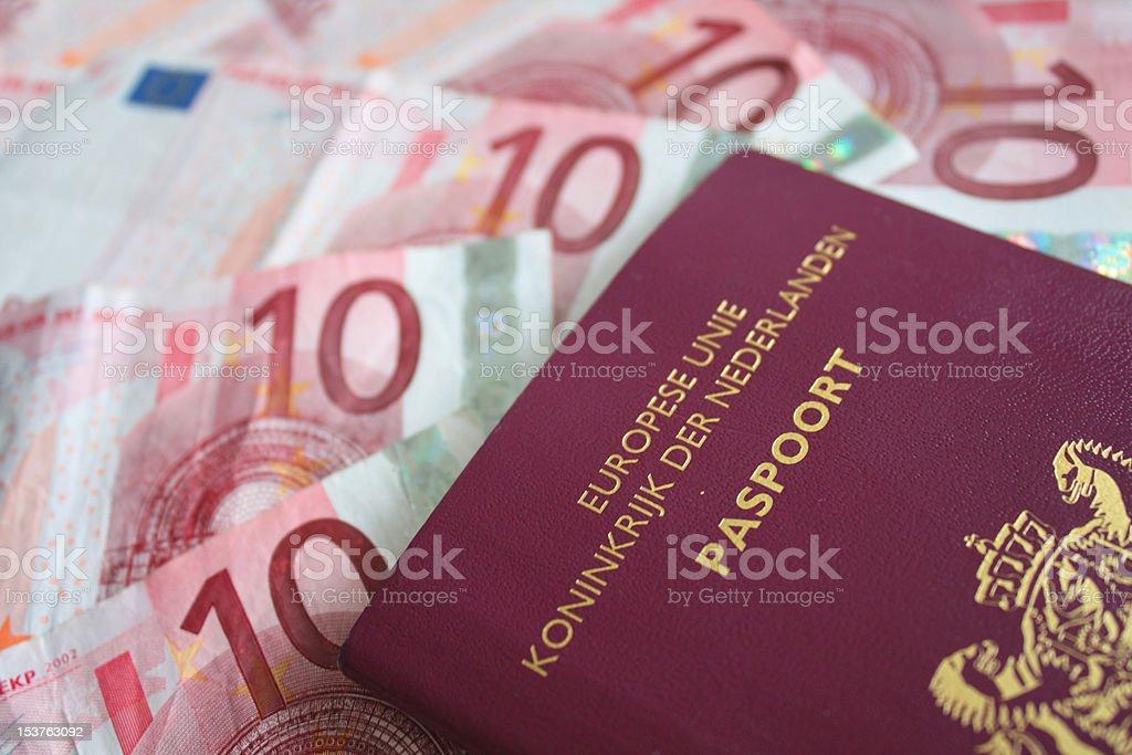 Cash and Dutch Passport stock photo