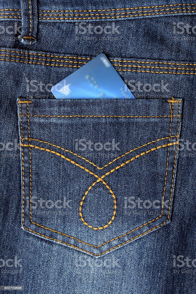 Cash card in jeans back pocket stock photo