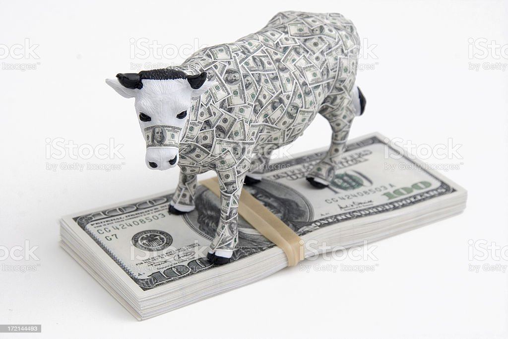 Cash Cow on pile of $ Money Bills royalty-free stock photo