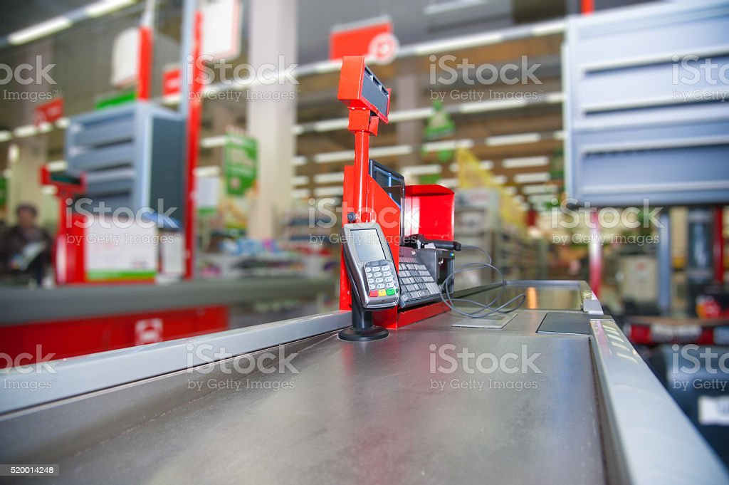 Cash desk with payment terminal in supermarket stock photo