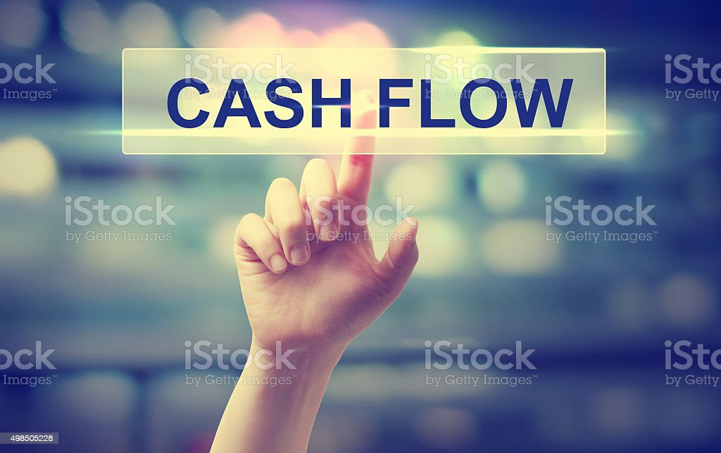 Cash Flow concept with hand pressing a button stock photo