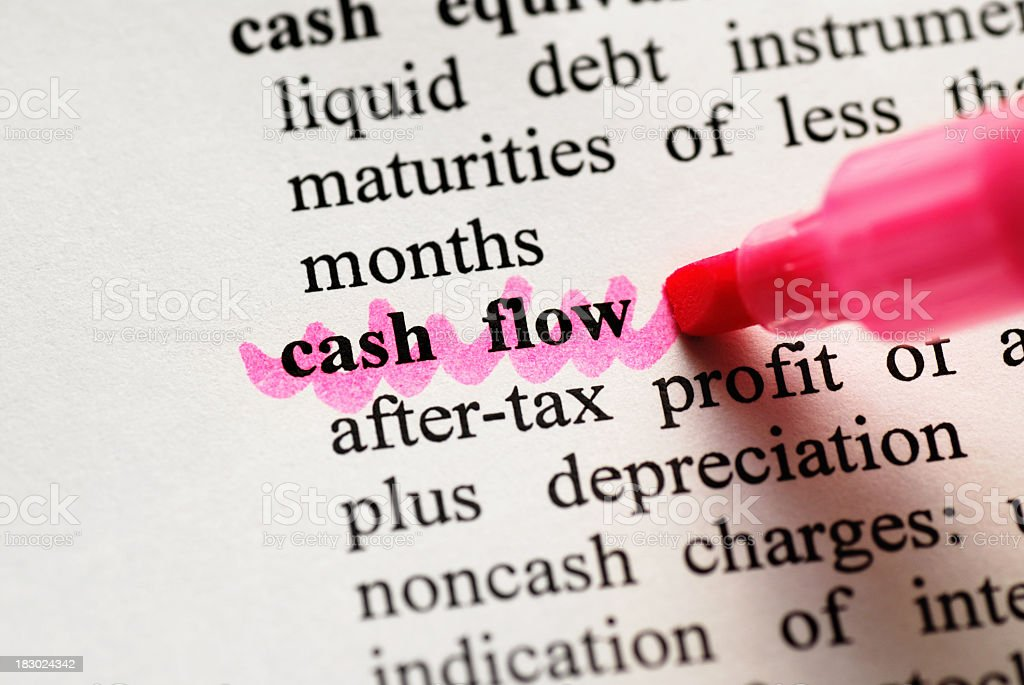 Cash Flow highlighted in dictionary royalty-free stock photo