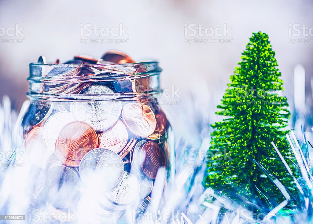 Cash for Christmas. Jar with American currency with Christmas tree stock photo