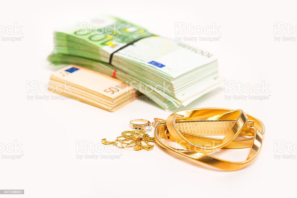Cash for gold jewelry and pile of euro banknotes stock photo