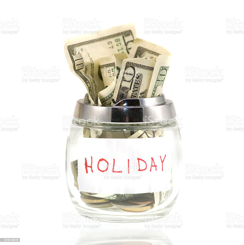 Cash for holiday in piggybank stock photo