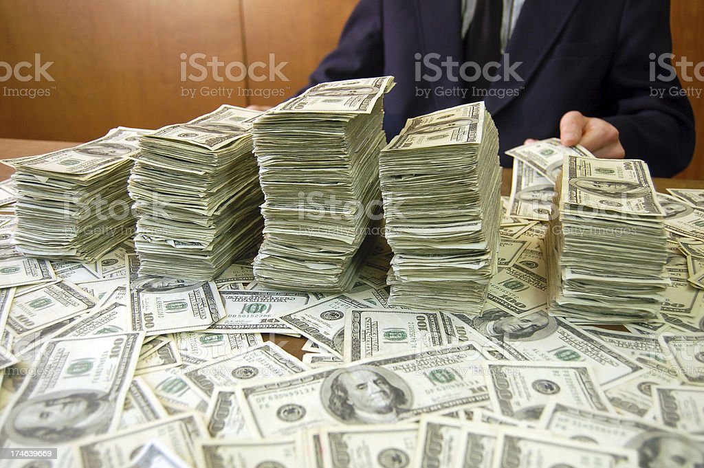 Cash in Stacks royalty-free stock photo