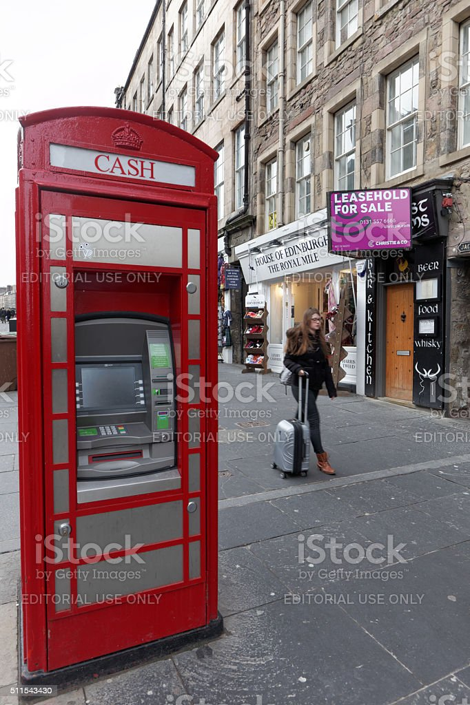 Cash machine in an old telephone box stock photo
