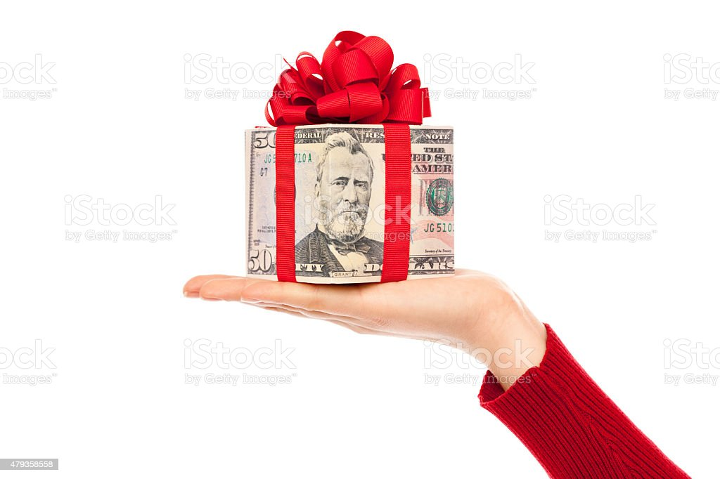 Cash Money Christmas Present of U.S. Currency on White Background stock photo