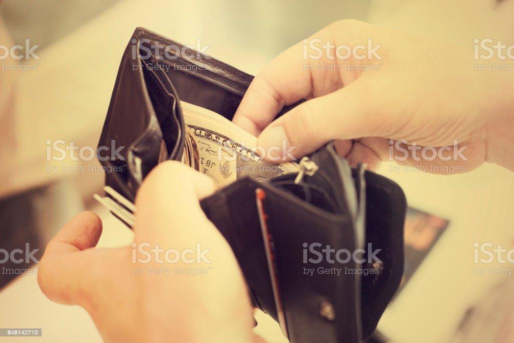 Cash money in your wallet in man's hands stock photo