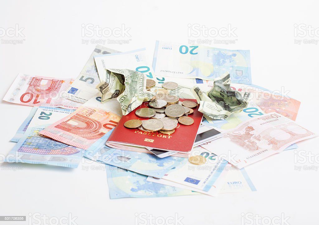 Cash on table isolated: dollars, euro, rubl broken money. All stock photo