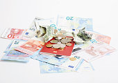 Cash on table isolated: dollars, euro, rubl broken money. All