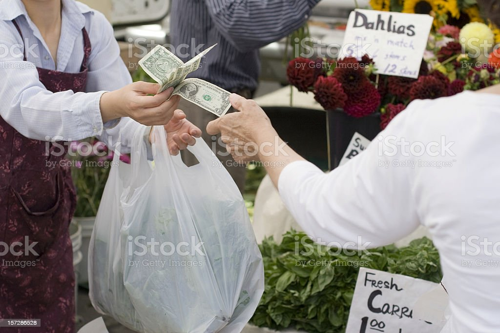 Cash payment for purchase at a farmers market. royalty-free stock photo
