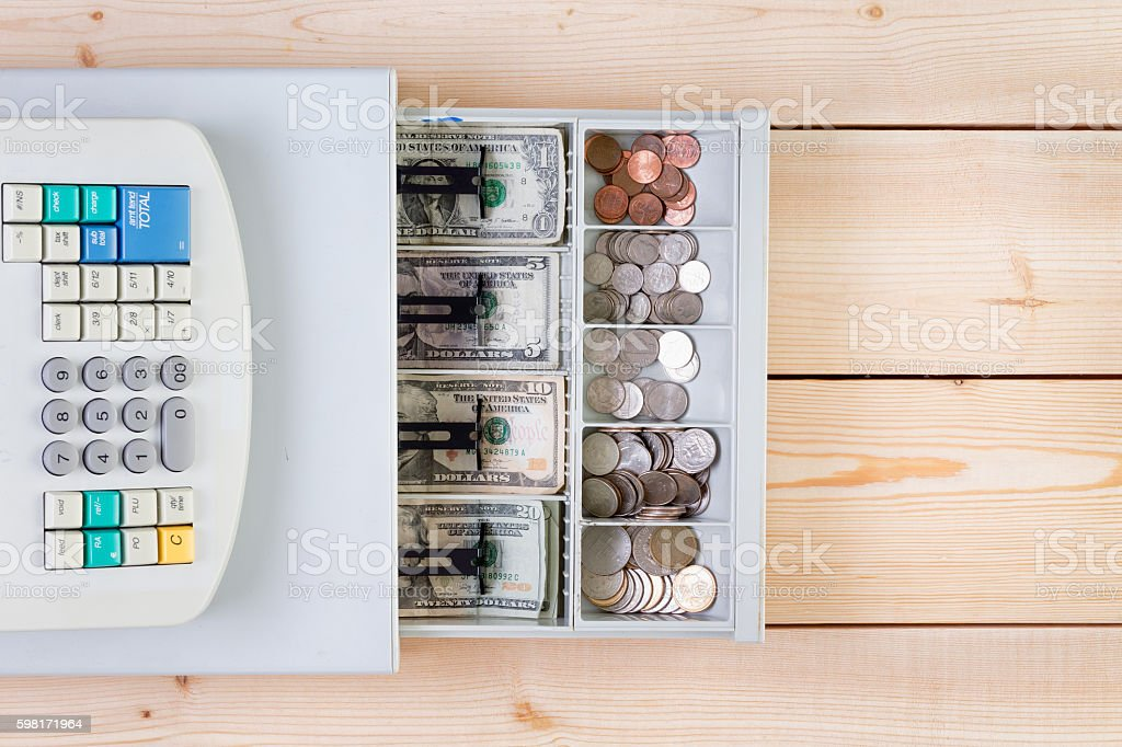 Cash register full of coins and paper money stock photo