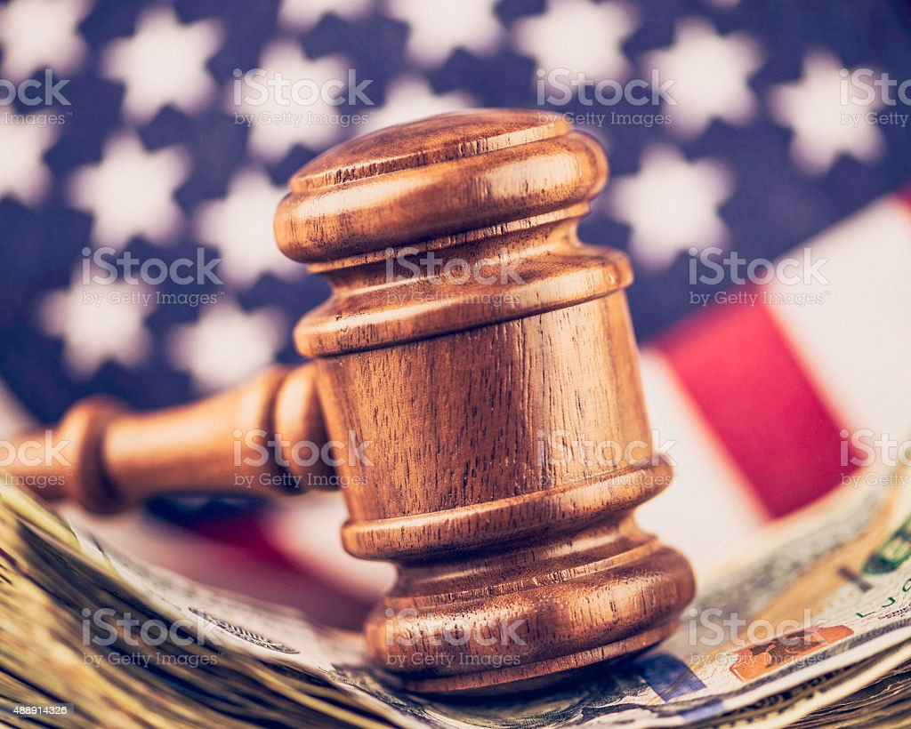 Cash settlement. American currency with gavel. Law and financial services. stock photo