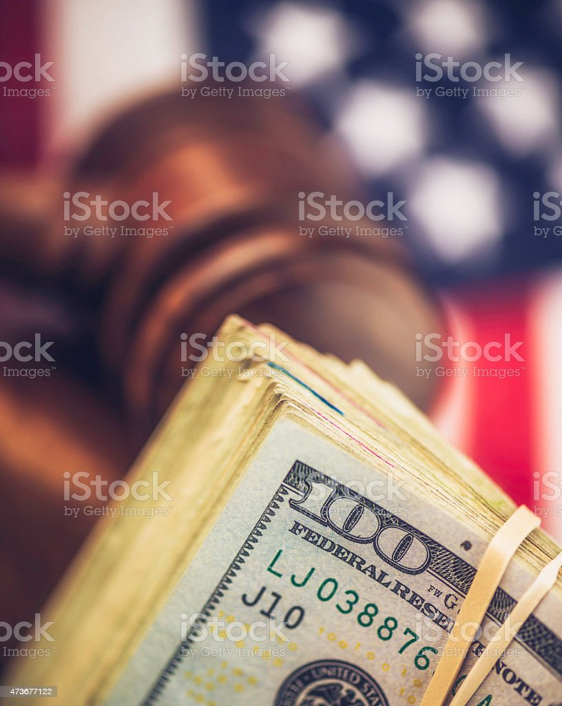 Cash settlement. American currency with gavel. Law, legal, financial, savings. stock photo