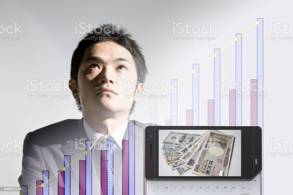 Cash to the businessman and mobile screen stock photo