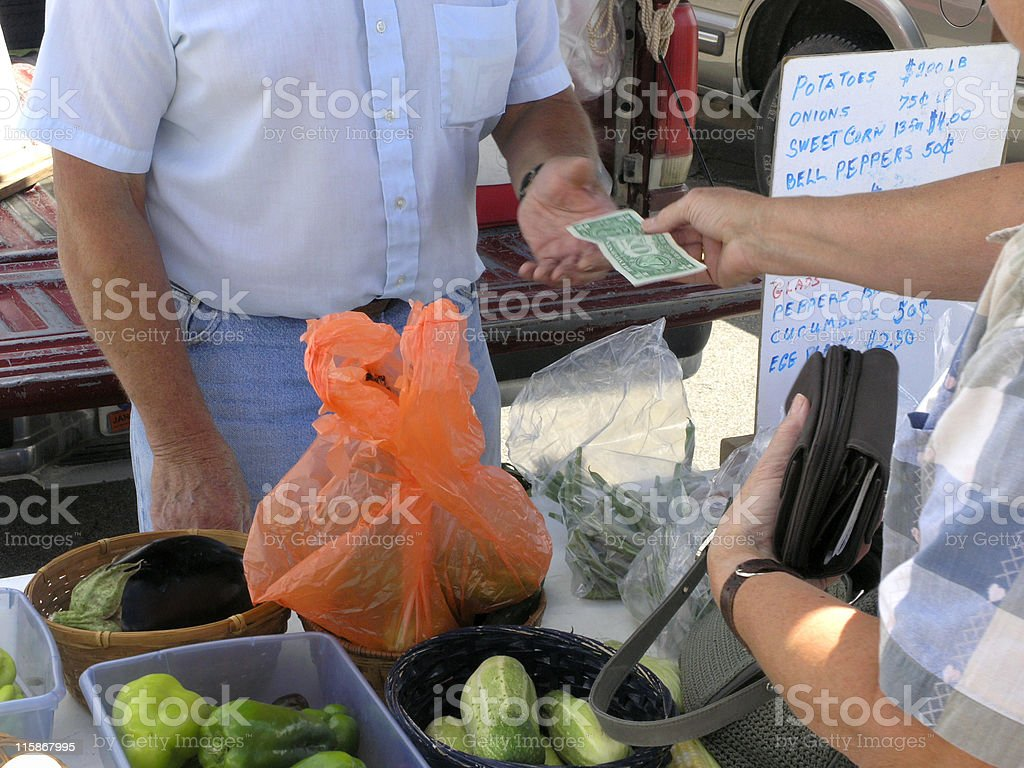 Cash Transaction, Money and Purse at Vegetable Stand stock photo