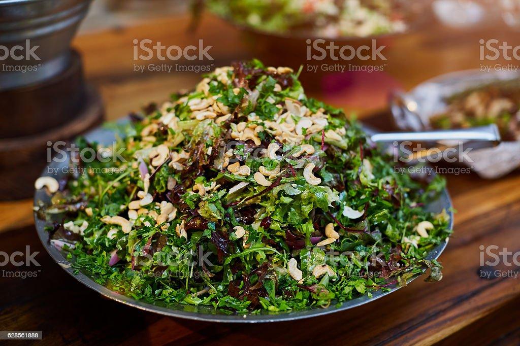 Cashew baby greens salad stock photo