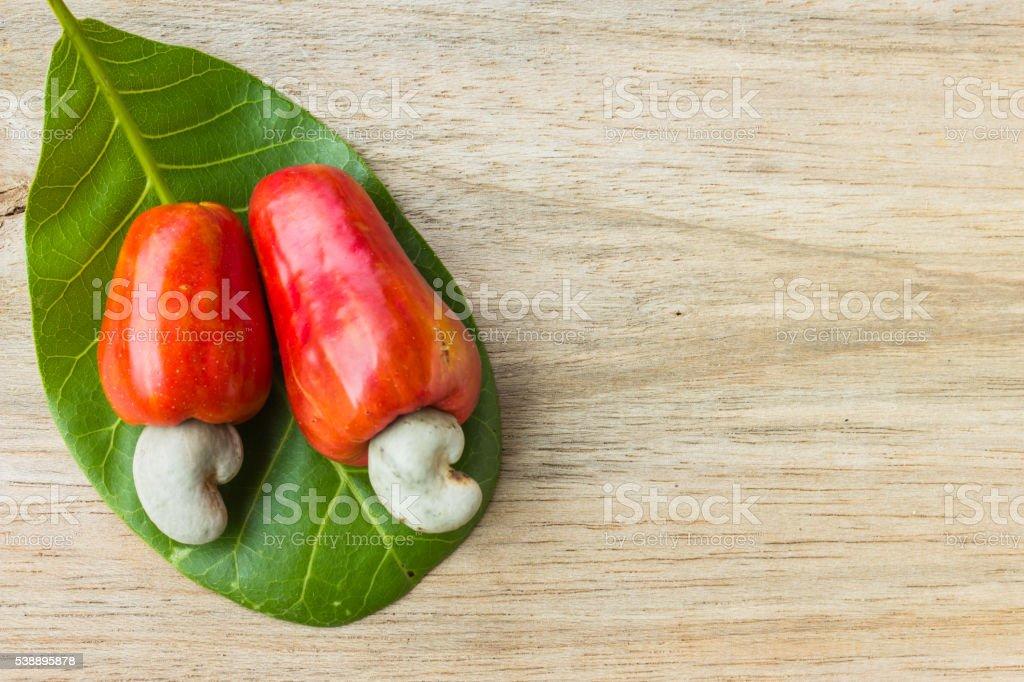 cashew nut and leaf on wood background stock photo