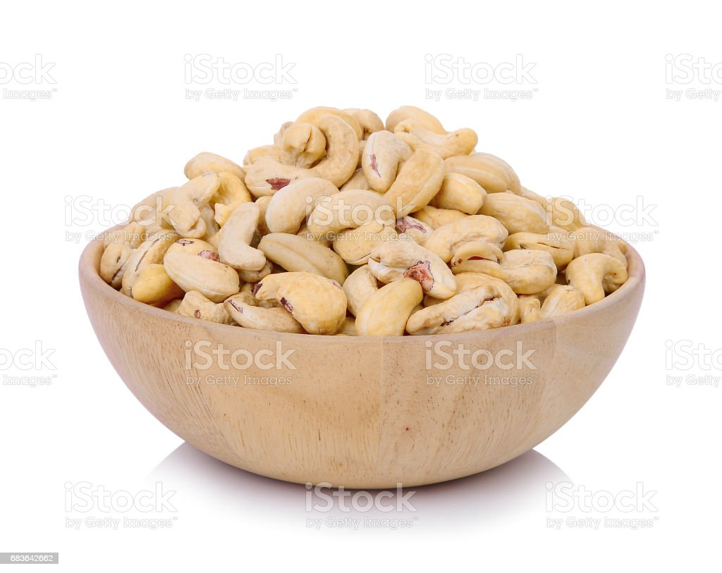 cashew nut in wooden bowl isolated on white background stock photo