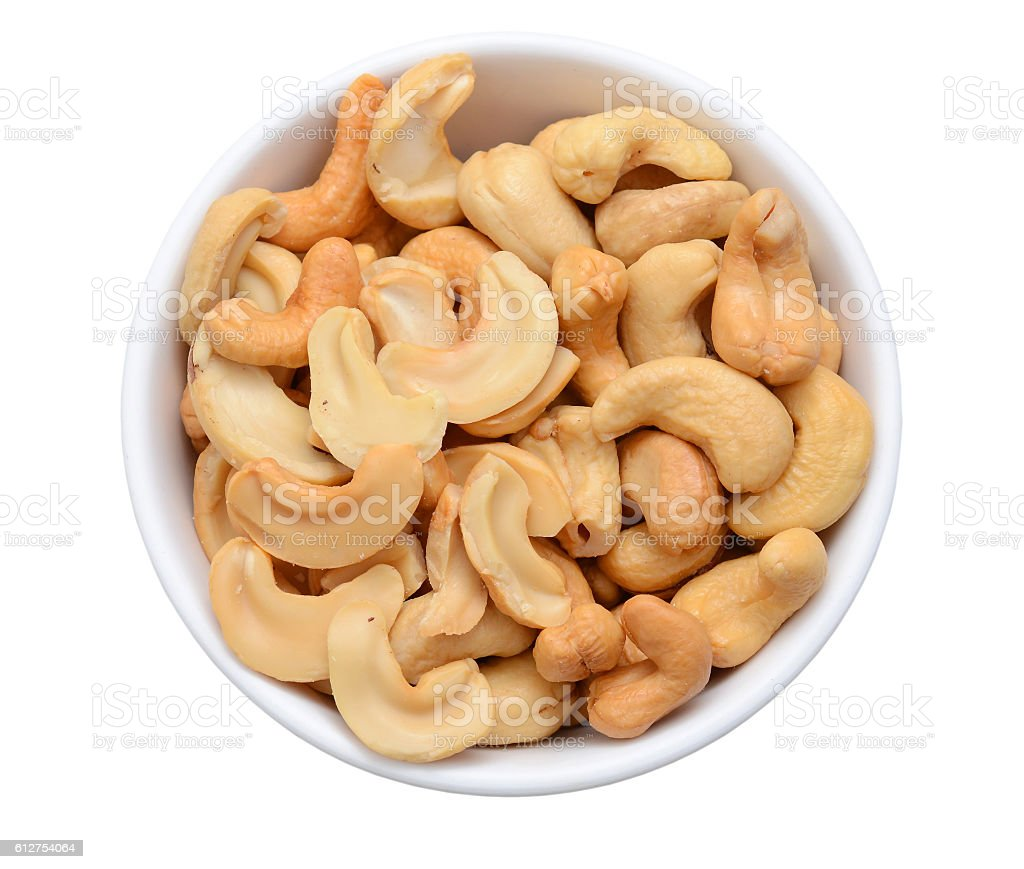 Cashew nuts in a bowl isolated on white background stock photo