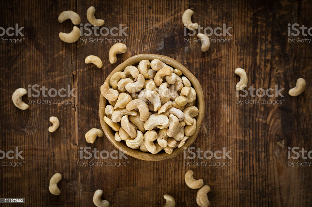 Cashew nuts in bowl, top view stock photo