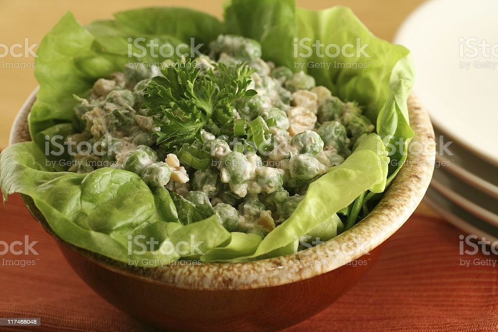 Cashew Pea Salad in Lettuce Bowl stock photo