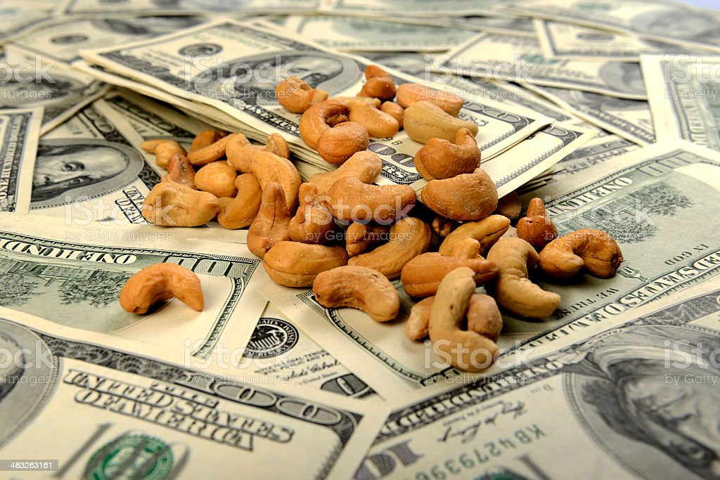 Cashews investment with US 100 dollars royalty-free stock photo