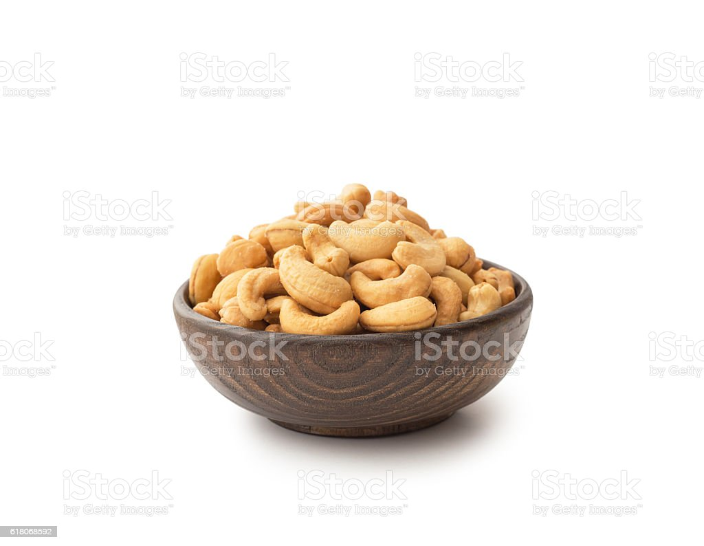 Cashews with wooden bowl stock photo