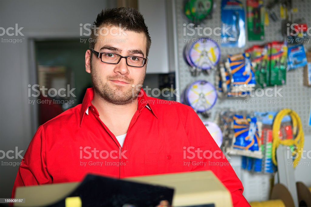 Cashier at Hardware Store royalty-free stock photo