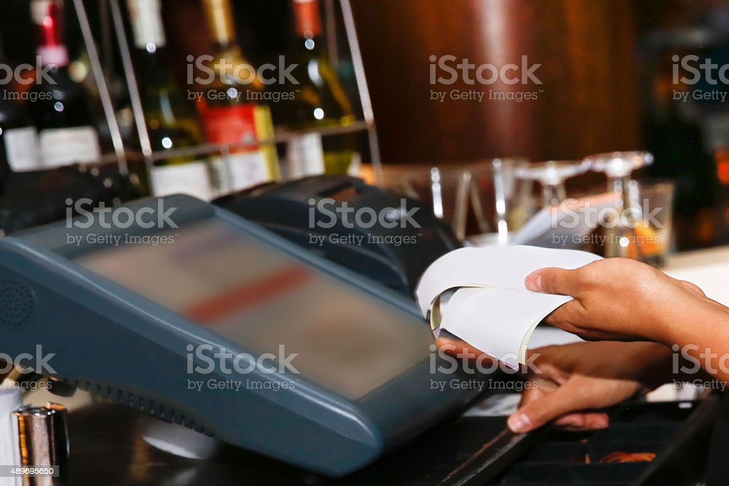 Cashier holding receipt stock photo