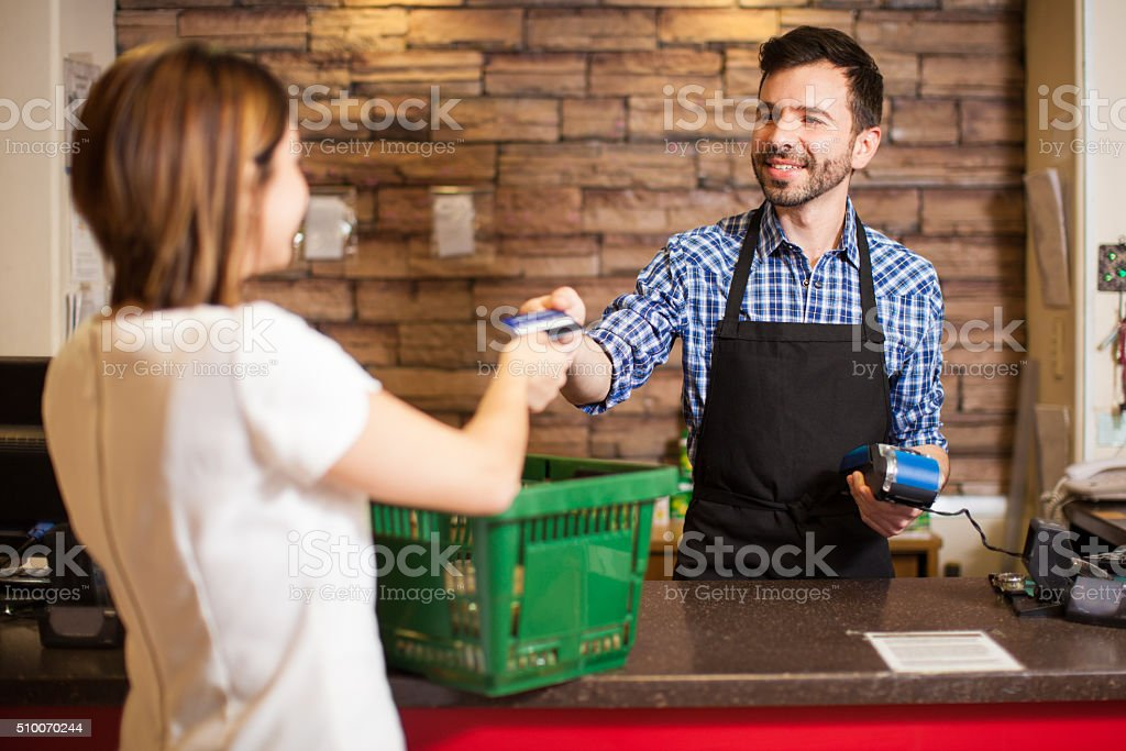 Cashier receiving a credit card payment stock photo