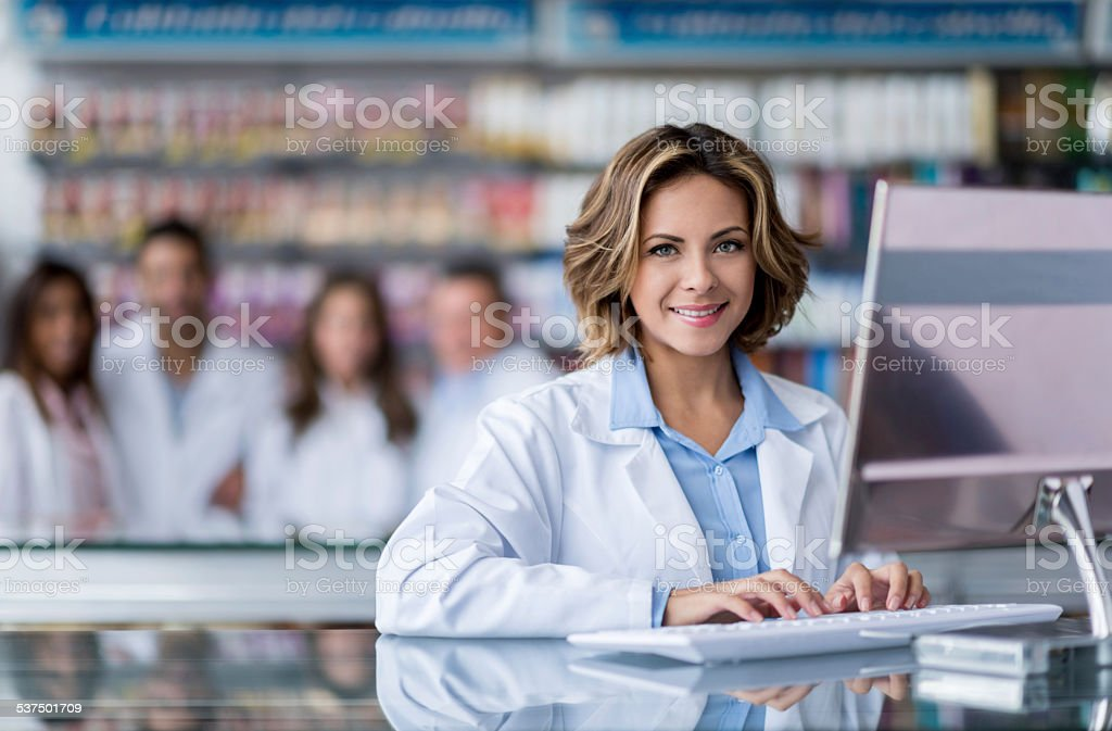 Cashier woman at the pharmacy stock photo