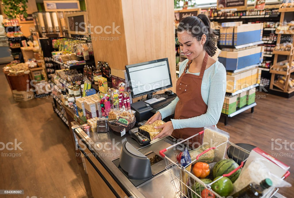 Cashier working at a supermarket stock photo