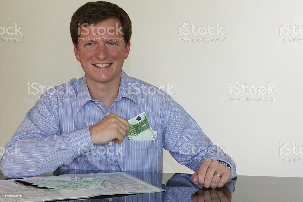 Cashing 100 Euro (horizontal) royalty-free stock photo